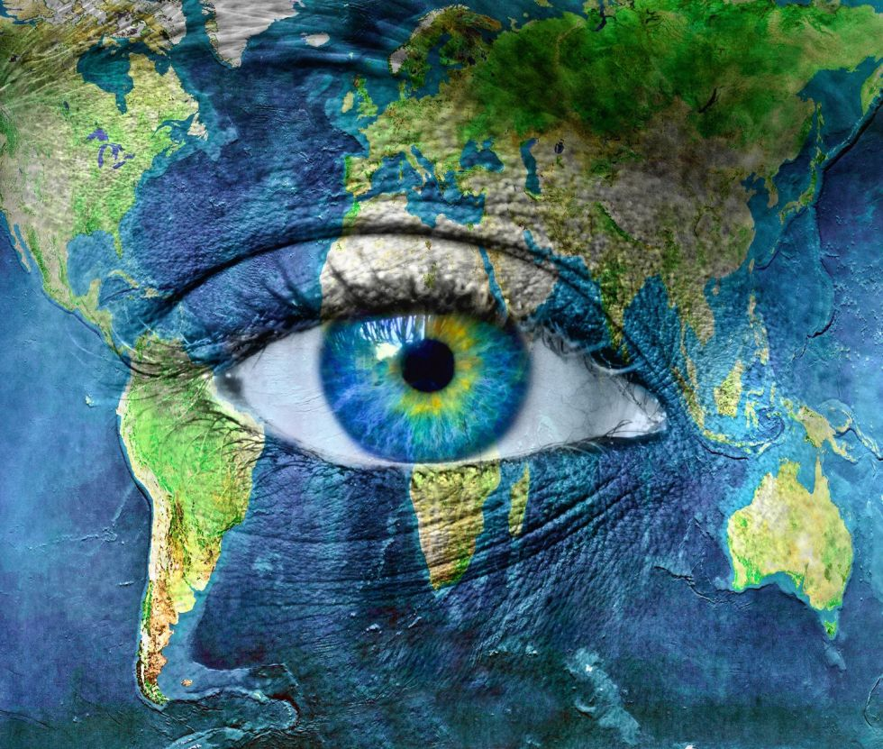 11699921 - planet earth and blue hman eye